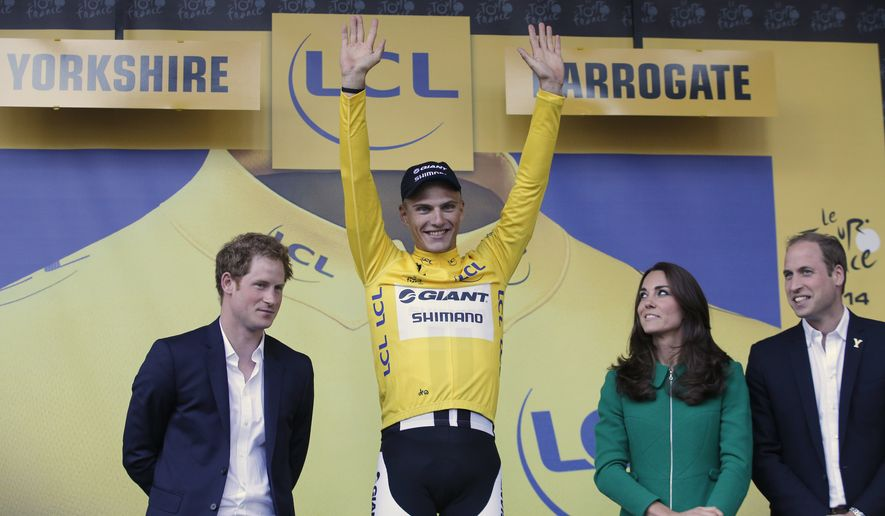 Britain's Prince Harry, left, Prince William, right, and Kate, Duchess of Cambridge, watch as Germany's sprinter Marcel Kittel, wearing the overall leader's yellow jersey, celebrates winning the first stage of the Tour de France cycling race over 190.5 kilometers (118.4 miles) with start in Leeds and finish in Harrogate, England, Saturday, July 5, 2014. (AP Photo/Christophe Ena)