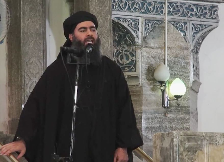** FILE ** This image made from video posted on a militant website Saturday, July 5, 2014, which has been authenticated based on its contents and other AP reporting, purports to show the leader of the Islamic State group, Abu Bakr al-Baghdadi, delivering a sermon at a mosque in Iraq. (AP Photo/Militant video)
