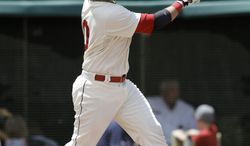 Cleveland Indians' Yan Gomes watches his ball after hitting a two-run home run off Kansas City Royals starting pitcher Danny Duffy in the second inning of a baseball game on Sunday, July 6, 2014, in Cleveland. Indians' Ryan Raburn also scored on the play. (AP Photo/Tony Dejak)