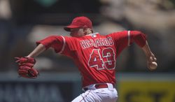 Los Angeles Angels starting pitcher Garrett Richards throws to the plate during the first inning of a baseball game against the Houston Astros, Sunday, July 6, 2014, in, Anaheim, Calif.  (AP Photo/Mark J. Terrill)