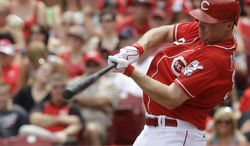 Cincinnati Reds' Jay Bruce hits a two-run home run off Milwaukee Brewers relief pitcher Will Smith in the eighth inning of a baseball game, Sunday, July 6, 2014, in Cincinnati. Cincinnati won 4-2. (AP Photo/Al Behrman)