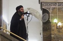 Abu Bakr al-Baghdadi has positioned about 3,000 ISIL fighters in Iraq and some 7,000 in Syria, officials say. (Associated Press)
