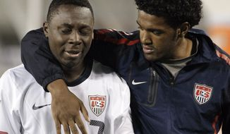 United States' Freddy Adu (7) is consoled as he leaves the field after the United States tied 3-3 with El Salvador in a CONCACAF Olympic qualifying soccer match on Monday, March 26, 2012, in Nashville, Tenn. El Salvador scored in extra time to cause a 3-3 draw, eliminating the United States from Olympic qualifying. (AP Photo/Mark Humphrey)