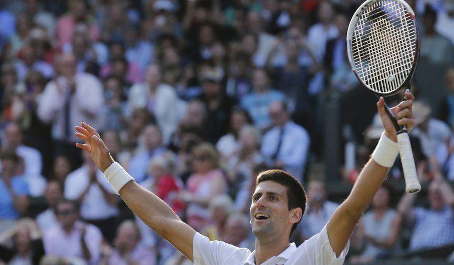 Novak Djokovic of Serbia celebrates defeating Roger Federer of Switzerland in the men's singles final at the All England Lawn Tennis Championships in Wimbledon, London, Sunday July 6, 2014. (AP Photo/Ben Curtis)