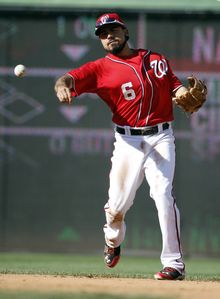 Washington Nationals second baseman Anthony Rendon (6) throws to first base during a baseball game against the Chicago Cubs at Nationals Park, Saturday, July 5, 2014, in Washington. (AP Photo/Alex Brandon)