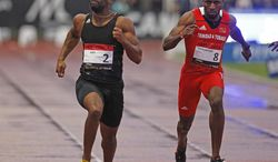 U.S. Tyson Gay, left, on his way to win the 100m men's race, ahead of Richard Thompson, right, from Trinida and Tobago, during the Athletics Montreuil meeting at the Jean Delbert stadium, in Montreuil, east of Paris, France, Monday July 7, 2014.  Tyson Gay clocked 10.04. (AP Photo/Remy de la Mauviniere)