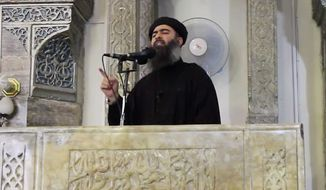 Abu Bakr al-Baghdadi is shown in a video delivering a sermon Friday at the Grand Mosque in Mosul, Iraq. His sudden public appearance after years of building and running his militant operations from hideouts suggests growing confidence in his security. (Associated Press)