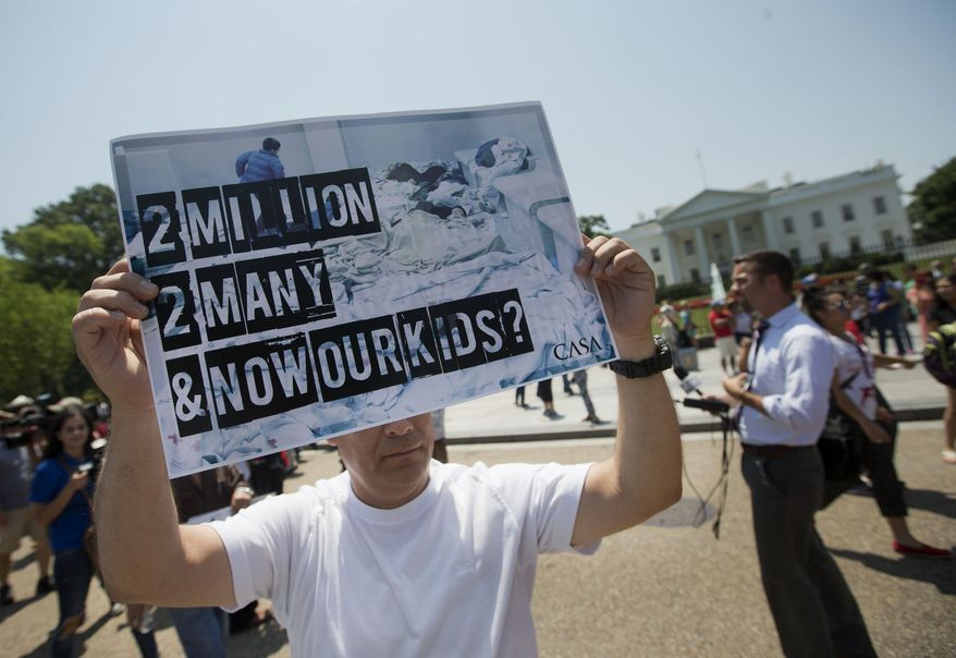 A demonstrator holds up a signs outside the White House in Washington, Monday, July 7, 2014, following a news conference of immigrant families and children's advocates responding to the President Barack Obama's response to the crisis of unaccompanied children and families illegally entering the US.  A top Obama administration official says no one, not even children trying to escape violent countries, can illegally enter the United States without eventually facing deportation proceedings. But Homeland Security Sec Jeh Johnson basically acknowledged Sunday that such proceedings might be long delayed, and he said that coping with floods of unaccompanied minors crossing the border is a legal and humanitarian dilemma for the US. (AP Photo/Pablo Martinez Monsivais)