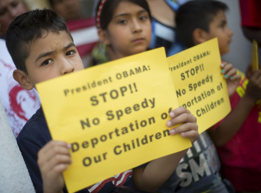From left, Raul Amador Sanchez, 7, from Georgia, Alexandra Diaz, 9, and her brother Andy Diaz, 7, both from Baltimore, Md., hold up signs as they join their parent during a news conference of immigrant families and children's advocates responding to the President Barack Obama's response to the crisis of unaccompanied children and families illegally entering the US, Monday, July 7, 2014, on the steps of St. John's Church in Washington. A top Obama administration official says no one, not even children trying to escape violent countries, can illegally enter the United States without eventually facing deportation proceedings. But Homeland Security Sec Jeh Johnson basically acknowledged Sunday that such proceedings might be long delayed, and he said that coping with floods of unaccompanied minors crossing the border is a legal and humanitarian dilemma for the US. (AP Photo/Pablo Martinez Monsivais)