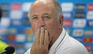Brazil's coach Luiz Felipe Scolari looks on during a news conference, the day before the World Cup semifinal soccer match between Brazil and Germany, at the Mineirao Stadium in Belo Horizonte, Brazil, Monday, July 7, 2014. (AP Photo/Andre Penner)