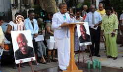 """Jersey City Councilwoman-at-Large Joyce Watterman speaks during a prayer vigil Monday, July 7, 2014, in Jersey City, N.J., for Ardie Fuqua, a comedian who was injured in the same car crash that killed James """"Uncle Jimmy Mack"""" McNair of Peekskill and seriously hurt Tracy Morgan.  (AP Photo/The Jersey Journal,  Michael Dempsey)"""