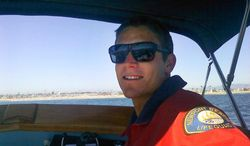 This undated photo provided by the Newport Beach Police Department shows Ben Carlson, 32, a Newport Beach lifeguard who drowned while trying to rescue a swimmer off the Southern California beach on Sunday, July 6, 2014.  Carlson was pulled from the water by fellow lifeguards following a frantic, three-hour search. The 15-year department veteran went into the water to help a swimmer struggling in the water when they were hit by a large wave. (AP Photo/Newport Beach Police Department)