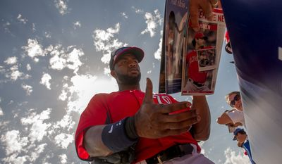 Washington Nationals center fielder Denard Span (2) signs autographs before the Washington Nationals play the Florida Marlins during spring training at Space Coast Stadium, Viera, Fla., Wednesday, February 27, 2013. (Andrew Harnik/The Washington Times)