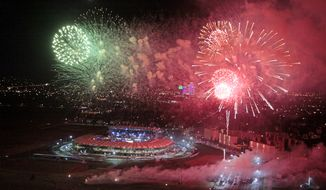 """Fireworks explode over the Ahmat Arena, after the WBA heavyweight boxing championship fight between Uzbekistan's Ruslan Chagaev and Fres Oquendo of the United States, in Grozny, Russia, Monday, July 7, 2014. Former WBA heavyweight champion Chagaev became a two-time champ, as he won a 12-round majority verdict over Fres Oquendo to pick up the """"regular"""" WBA strap. (AP Photo/Musa Sadulayev)"""