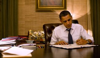 President Barack Obama signs paperwork in his private office in the residence of the White House, March 2, 2010. (Official White House Photo by Pete Souza)