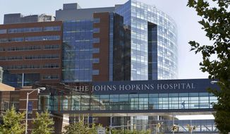 This Oct. 2, 2013, file photo shows part of the Johns Hopkins Hospital complex in Baltimore. (AP Photo/Patrick Semansky, File)