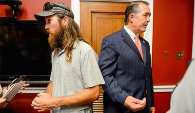 Jase Robertson, right, of the television show Duck Dynasty and Rep. Trent Franks (R-Ariz.), right, speak to reporters at Rep. Frank's Capitol Hill Office, Washington, D.C., Tuesday, July 8, 2014. Robertson was on the hill with her daughter Mia to visit with Rep. Frank. Both Rep. Frank and Mia have had cleft palate surgery, and the Robertson family has started the Mia Moo Fund, a non-profit organization that is dedicated to raising awareness and funds towards research, treatments and causes of cleft lip & palate. (Andrew Harnik/The Washington Times)