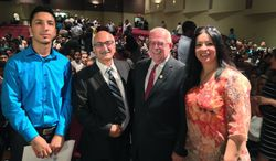 Khalil Mahmoud who worked as an interpreter for the U.S. military in Iraq was sworn in as a U.S. citizen on Tuesday, July 8, 2014.  From left, Mahmoud's son Aras Mahmoud, Khalid Mahmoud ,Congressman Gerry Connolly, and his wife Najat Amen
