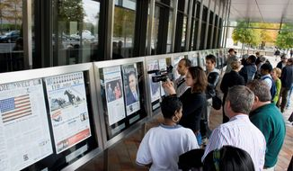 Part of the tower (left) that previously broadcast radio and television signals from the World Trade Center is displayed as part of an exhibit about coverage of the Sept. 11, 2001 attacks, at the Newseum. The The goal of the Newseum (top) is to educate visitors on the First Amendment. Visitors (above) crowd outside the building to read a display of newspaper front pages. The Newseum showcases a selection of more than 800 front pages from newspapers across the country and around the world. (Associated Press Photographs)