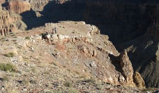 In this Nov. 16, 2008 photo provided by the Grand Canyon National Park Service, the Grand Canyon National Park National Historic Landmark nomination field team documents and records the United Airlines impact site at the east end of the Grand Canyon. Two commercial airplanes, United 718 and TWA flight crashed on June 30, 1956 over the Grand Canyon, killing all 128 people aboard in one of the deadliest aviation disasters in the U.S. On Tuesday, July 8, 2014, the Grand Canyon National Park will mark the designation of the crash site as a National Historic Landmark in a ceremony overlooking the gorge where the wreckage was scattered over 1.5 square miles. (AP Photo/Grand Canyon National Park Service)