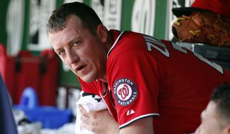 Washington Nationals starting pitcher Jordan Zimmermann pauses in the dugout during a baseball game against the Chicago Cubs at Nationals Park, Sunday, July 6, 2014, in Washington. (AP Photo/Alex Brandon)