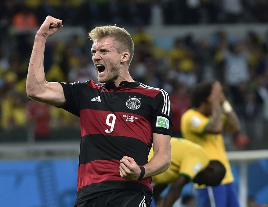 Germany's Andre Schuerrle celebrates after scoring his side's sixth goal during the World Cup semifinal soccer match between Brazil and Germany at the Mineirao Stadium in Belo Horizonte, Brazil, Tuesday, July 8, 2014. (AP Photo/Martin Meissner)