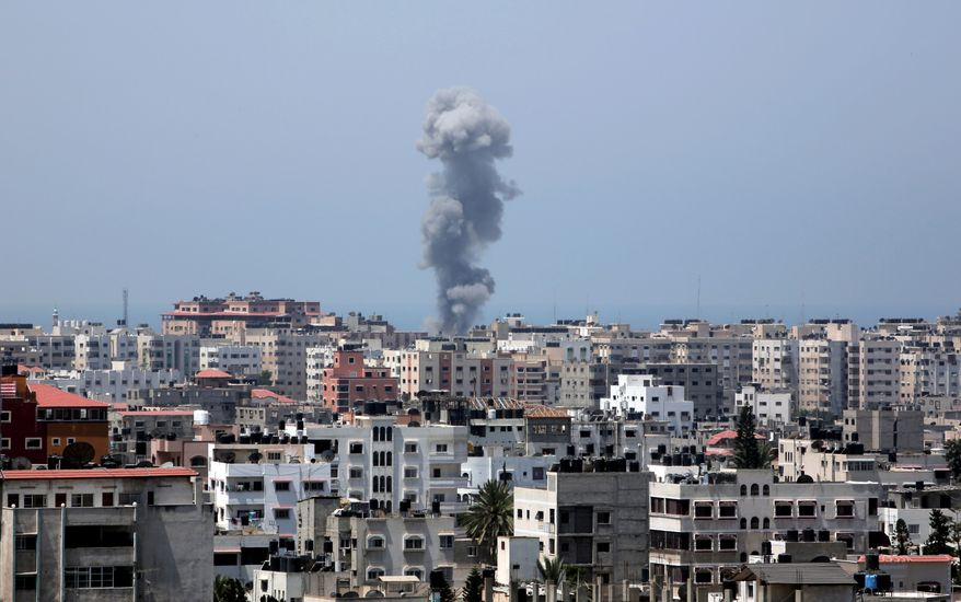 Smoke rises after an Israeli missile strike in Gaza City, Tuesday, July 8, 2014. The Israeli military launched what could be a long-term offensive against the Hamas-ruled Gaza Strip on Tuesday, striking at least 50 sites in Gaza by air and sea and mobilizing troops for a possible ground invasion aimed at stopping a recent barrage of rocket attacks against Israel. (AP Photo/Khalil Hamra)