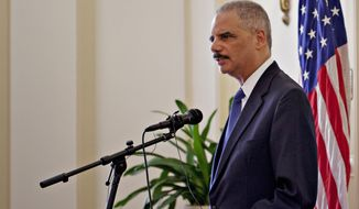 US Attorney General Eric Holder speaks at the US ambassador's residence in Oslo Tuesday July 8, 2014.  Holder is in Norway to make a major address on international efforts to confront the security threat posed by violent extremists traveling to and from Syria.  (AP Photo/Anette Karlsen / NTB scanpix)