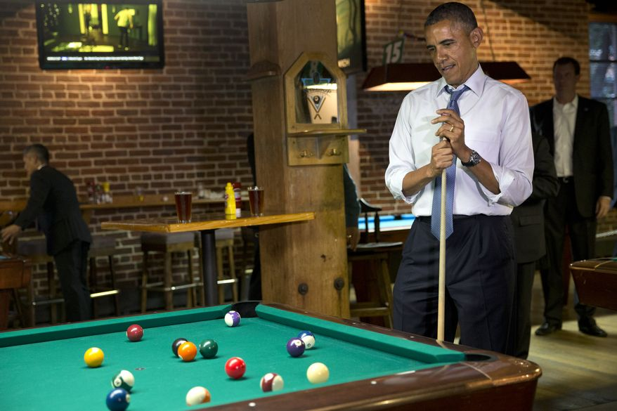 President Barack Obama plays pool at Wynkoop Brewing Co. with Colorado Gov. John Hickenlooper on Tuesday, July 8, 2014, in Denver. Obama is expected to attend a fundraiser and speak about the economy in Denver on Wednesday. (AP Photo/Jacquelyn Martin)