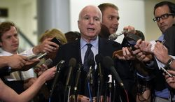 Sen. John McCain, R-Ariz. speaks to reporters on Capitol Hill in Washington, Tuesday, July 8, 2014. (AP Photo/Susan Walsh) ** FILE **