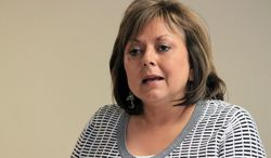 """FILE - In this April 2, 2014 file photo, New Mexico Gov. Susana Martinez speaks during a news conference in Albuquerque, N.M. Martinez is blaming President Barack Obama and Congress for the surge in Central American immigrants attempting to enter the country illegally. The Republican says immigrant parents are dropping off their children at the border and are """"expecting the federal government to just throw up its hands and let them in."""" (AP Photo/Susan Montoya Bryan, File)"""