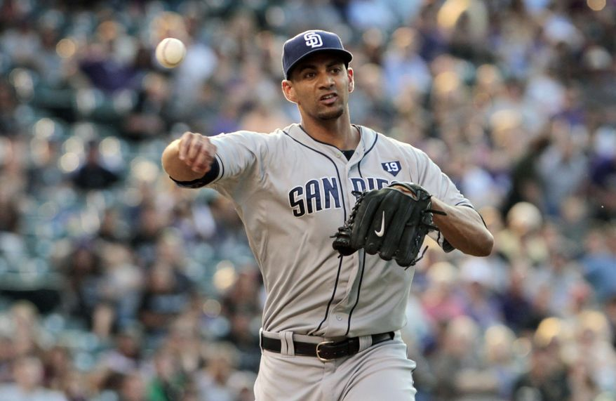 San Diego Padres starting pitcher Tyson Ross (38) throws to first base to put out Colorado Rockies' Justin Morneau in the first inning of a baseball game in Denver on Tuesday, July 8, 2014. (AP Photo/Joe Mahoney)