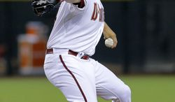 Arizona Diamondbacks pitcher Vidal Nuno throws in his Diamondbacks debut against the Miami Marlins during the first inning of a baseball game, Tuesday, July 8, 2014, in Phoenix. (AP Photo/Matt York)