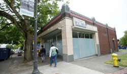 People walk past the building housing Main Street Marijuana in late June 2014 in Vancouver, Wash. Main Street Marijuana expects to open Wednesday, after receiving a state license to sell marijuana. The closest legal pot shop to Portland, Ore., opens Wednesday, just across the river in Vancouver. Wash. (AP Photo/The Columbian, Steve Lane)