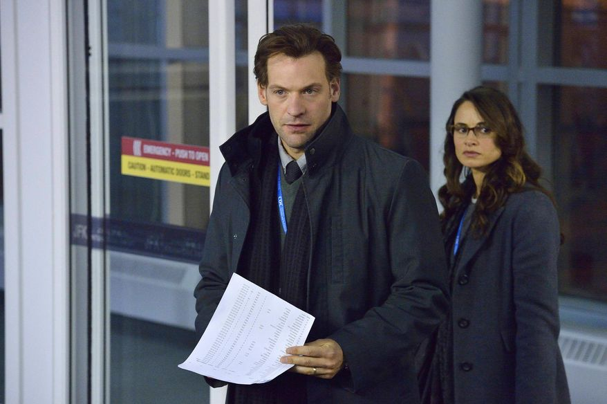"This image released by FX shows Corey Stoll, left, and Mia Maestro in a scene from the new series ""The Strain,"" premiering July 13. The vampire thriller begins when a mysterious viral outbreak spreads to New York. Stoll stars as the head of a Centers for Disease Control task force battling this global threat. (AP Photo/FX, Michael Gibson)"