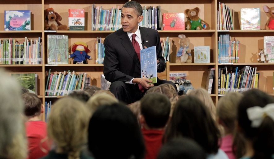 President Obama shares his interest in books with schoolchildren. His own titles still seem to be popular at the State Department, which has spent $15,000 on copies for the U.S. Embassy in Paris, a procurement database shows. (Associated Press)