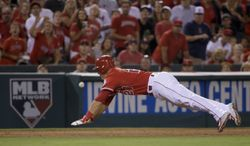 Los Angeles Angels' Mike Trout is thrown out at third by Toronto Blue Jays left fielder Melky Cabrera during the sixth inning of a baseball game in Anaheim, Calif., Tuesday, July 8, 2014. (AP Photo/Chris Carlson)