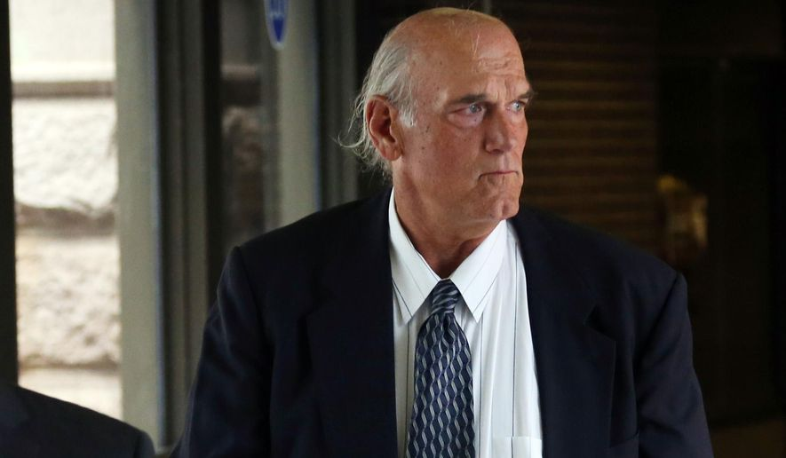 Former Minnesota Gov. Jesse Ventura makes his way back into Warren E. Burger Federal Building during the first day of jury selection in a defamation lawsuit, Tuesday, July 8, 2014 in St. Paul, Minn. Ventura filed the defamation lawsuit against the late Navy Seal Chris Kyle's estate, claiming that Kyle's account of a bar fight in a book he wrote was false. (AP Photo/Jim Mone)