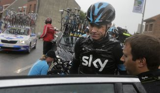 Britain's Christopher Froome gets into his team car after abandoning the race following a third consecutive crash in two days during the fifth stage of the Tour de France cycling race over 155 kilometers (96.3 miles) with start in Ypres, Belgium, and finish in Arenberg, France, Wednesday, July 9, 2014. The stage initially contained nine sectors of cobblestone roads dreaded by the majority of the riders in the pack especially under wet conditions, the organization decided to cancel two of the nine stretches because of the weather. (AP Photo/Laurent Cipriani)