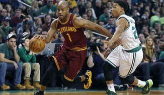 FILE - In this Dec. 28, 2013 file photo, Cleveland Cavaliers' Jarrett Jack (1) drives past Boston Celtics' Phil Pressey (26) in the second quarter of an NBA basketball game in Boston. A person familiar with the deals says the Cavaliers have agreed to trade Jack, swingman Sergey Karasev and center Tyler Zeller, moves that can help their pursuit of LeBron James by clearing salary cap space. The Cavs have agreements with the Brooklyn Nets and Boston Celtics, according to the person who spoke Wednesday, July 9, 2014, to The Associated Press. The person spoke on condition of anonymity because teams are not permitted to discuss any trades until the league's moratorium ends Thursday. (AP Photo/Michael Dwyer, File)