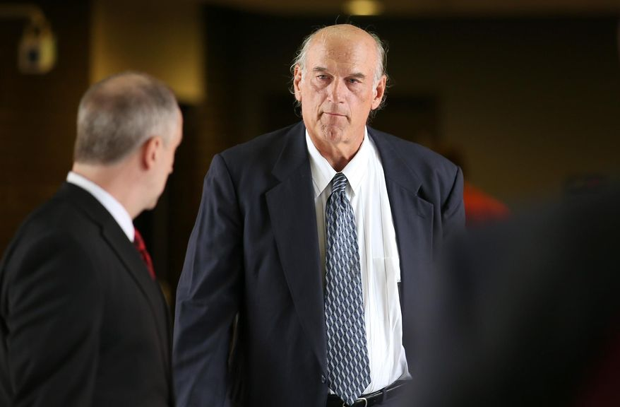 ** FILE ** Former Minnesota Gov. Jesse Ventura, right, made his way back into Warren E. Burger Federal Building during the first day of jury selection in a defamation lawsuit, Tuesday, July 8, 2014 in St. Paul, Minn. (AP Photo/The Star Tribune, Elizabeth Flores)