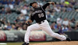 Colorado Rockies starting pitcher Franklin Morales (56) pitches against the San Diego Padres in the first inning of a baseball game in Denver on Tuesday, July 8, 2014. (AP Photo/Joe Mahoney)