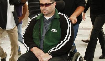 A wheelchair bound Bryan Stow, assisted by a caregiver, is surrounded by family and media as he is led into the Los Angeles County Superior Courthouse in downtown Los Angeles, Wednesday, June 25, 2014, as the trial goes into the last day before closing arguments for the trial of Stow's lawsuit against former Dodgers owner Frank McCourt and three team entities he created. The suit filed on behalf of the San Francisco Giants fan alleges the franchise was negligent for not having enough security to prevent an Opening Day 2011 attack by Dodger fans that left him with permanent brain damage. (AP Photo/Los Angeles Times, Al Seib)