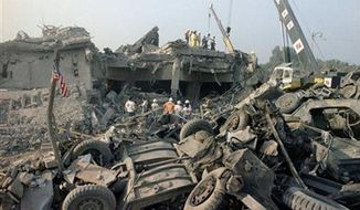 The aftermath of a suicide truck bombing of the U.S. Marines barracks in Beirut, Lebanon on Sunday, Oct. 23, 1983. The blast claimed the lives of 241 American service members. (AP Photo/Jim Bourdier, File)