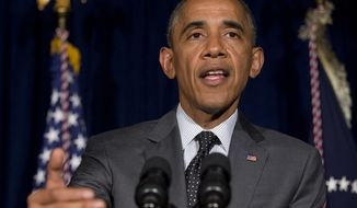 President Barack Obama speaks at a news conference after meeting with Gov. Rick Perry in Dallas about immigration on Wednesday, July 9, 2014. (AP Photo/Jacquelyn Martin)