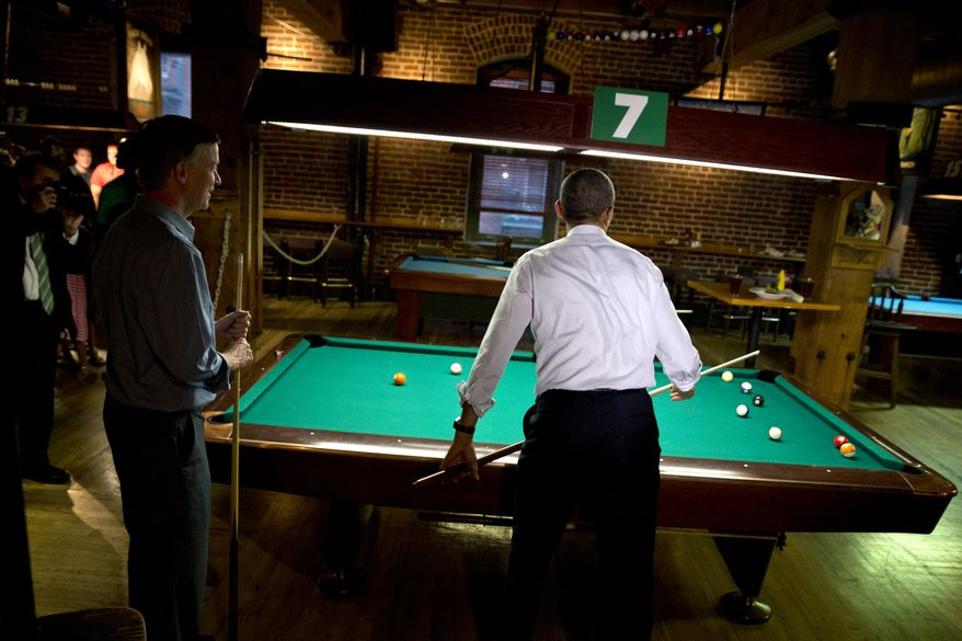 President Barack Obama, right, plays pool with Colorado Gov. John Hickenlooper at Wynkoop Brewing Co. on Tuesday, July 8, 2014, in Denver. Obama is expected to attend a fundraiser and speak about the economy in Denver on Wednesday. (AP Photo/Jacquelyn Martin)