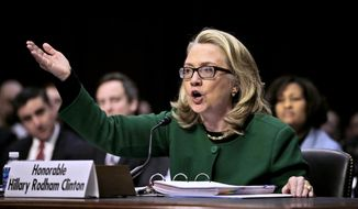 This Jan. 23, 2013, file photo shows Secretary of State Hillary Rodham as she testifies on Capitol Hill in Washington before the Senate Foreign Relations Committee hearing on the deadly attack on the U.S. diplomatic mission in Benghazi, Libya. (AP Photo/Pablo Martinez Monsivais) ** FILE **