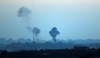 Israel dramatically escalated its aerial assault in Gaza Thursday hitting hundreds of Hamas targets. The Health Ministry in Gaza reported 22 people killed in a single day. Israel's missile defense system once again intercepted rockets fired by militants. (Associated Press)