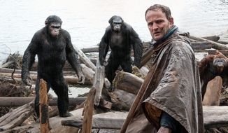 "Jason Clarke, stars as Malcolm (right), with (background from left), Andy Serkis, as Caesar and Toby Kebbell, as Koba, in a scene from the film, ""Dawn of the Planet of the Apes."" The film is both a great sequel and a great movie, expanding brilliantly on its already strong source material. It also makes a case to be the best movie of the summer. (Twentieth Century Fox Film Corporation via Associated Press)"