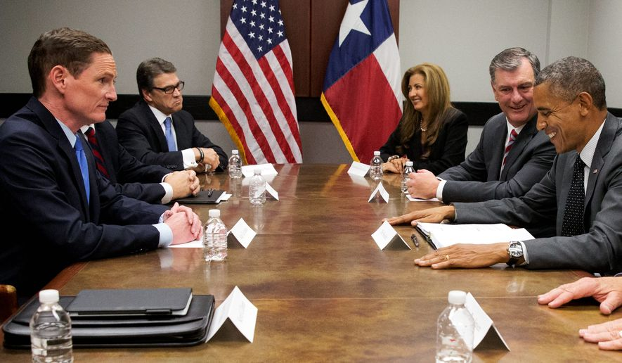 President Obama met with Texas Gov. Rick Perry on Wednesday but declined his offer to go to the Mexico border just 500 miles away. (Associated Press)